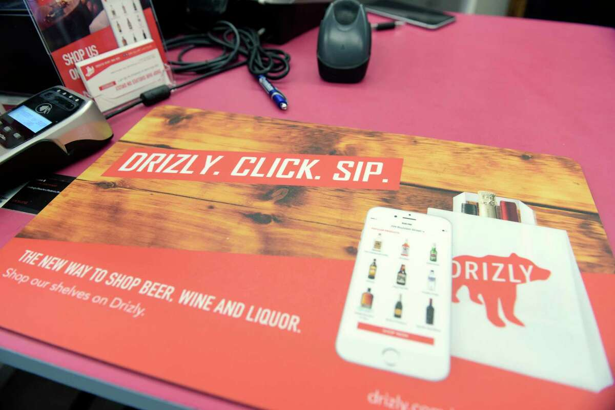 A view of a promotional card seen at Madison Wine and Spirits on Monday, Oct. 2, 2017, in Albany, N.Y. Drizly is an online app that lets customers order liquor online and have it delivered to their door. (Paul Buckowski / Times Union)