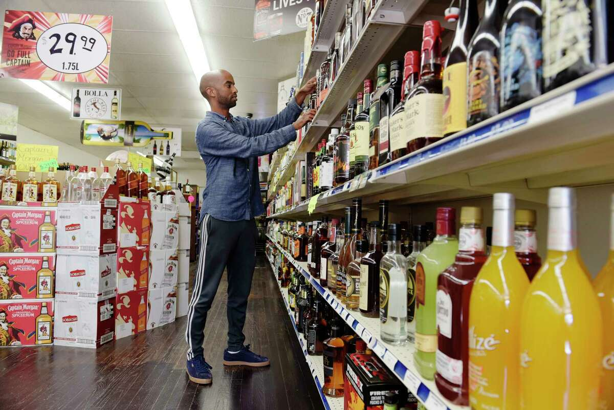 Sam Baatai, owner of Madison Wine and Spirits, at his store on Monday, Oct. 2, 2017, in Albany, N.Y. Baatai is using the online app Drizly so his customers have a new way to buy his product. Drizly is an online app that lets customers order liquor online and have it delivered to their door. (Paul Buckowski / Times Union)
