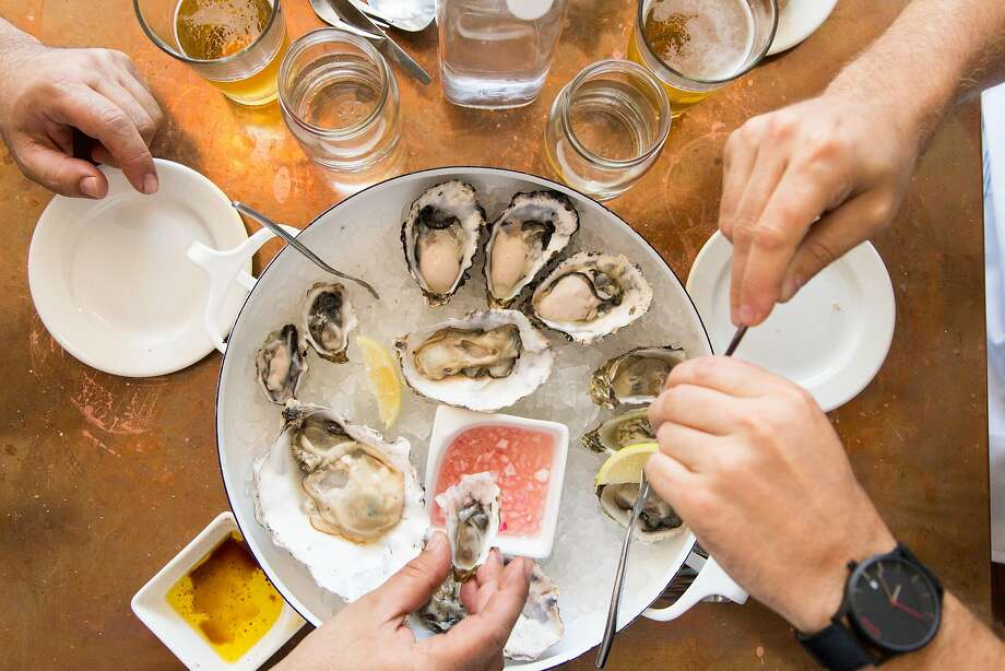 Eating oysters at Red Hill Station on Cortland Avenue in S.F. Photo: Jason Henry, Special To The Chronicle