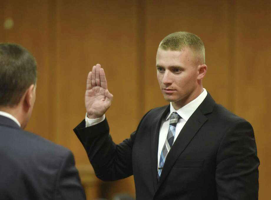 New Greenwich police officer Sean Beattie is sworn in at Town Hall in Greenwich, Conn. Monday, Oct. 2, 2017. Four new Greenwich police officers - Sean Beattie, Ryan Daly, Anthony D'Arco and Timothy MacDonald - were sworn in on Monday. Photo: Tyler Sizemore / Hearst Connecticut Media / Greenwich Time