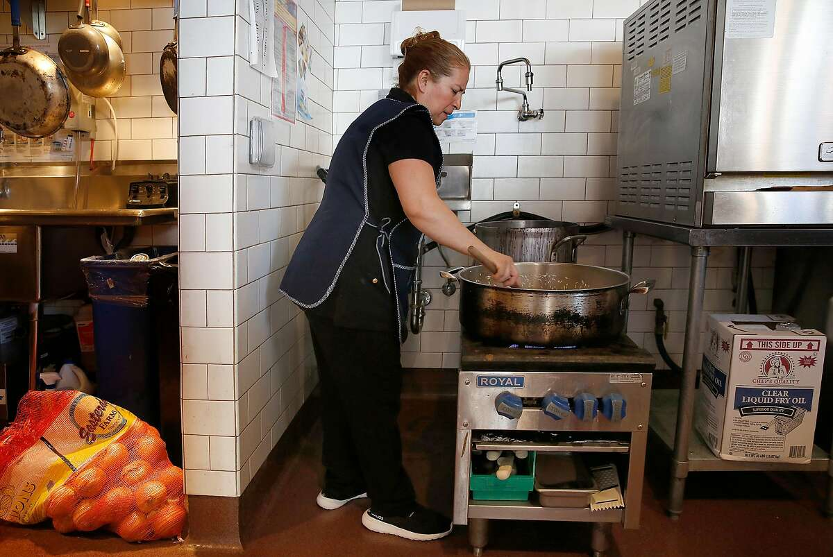 Isabel Caudillo makes rice at El Buen Comer on Wednesday, September 27, 2017, in San Francisco, Calif.