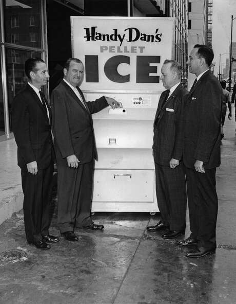 04/18/1962 - James H. Pappas, pres. of Pappas Refrigeration Co., 401 Louisiana, is poised to push the button to deliver a 10-pound bag of cylindrical pellet ice. Pappas Refrigeration is Gulf Coast distributor for the ice-vending machine. Paul S. Kamas, left, is proprietor of Vend-Ice, Inc., Houston dealer. At right are Dansby A. Council, pres. of Council Manufacturing Corp., Fort Smith, Ark., manufacturer of the machine; and Jerry Kaler, Pappas sales manager. Photo: Gunnar Liljequist, HC Staff / Houston Chronicle