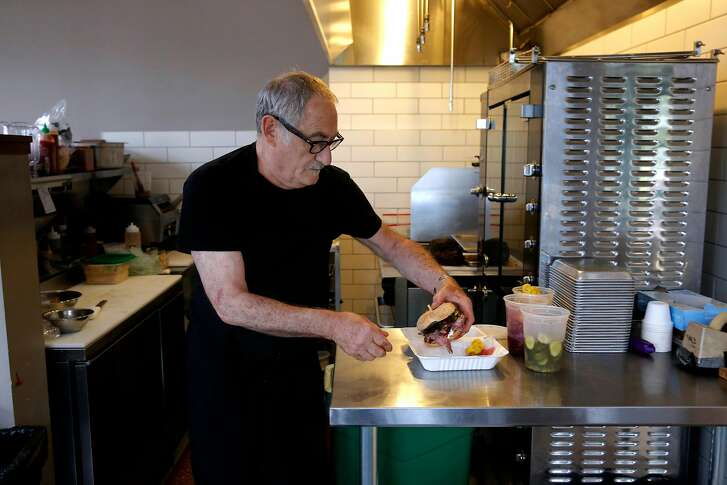 In the kitchen with Jeff Mason the chef-owner of Pal's Takeaway, a small pop-up sandwich shop located inside Forage Kitchen, in Oakland, Ca., as seen on Thurs. September 7, 2017.