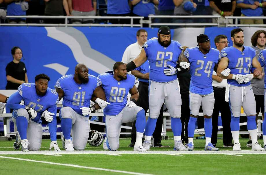 """FILE- In a file photo from Sept. 24, 2017, Detroit Lions defensive end Armonty Bryant (97), defensive tackle A'Shawn Robinson (91) and defensive end Cornelius Washington (90) take a knee during the national anthem before an NFL football game against the Atlanta Falcons, in Detroit. The sight of football players kneeling during the national anthem across the United States is the continuation of a tradition nearly as old the song itself. University of Michigan musicology professor Mark Clague says """"The Star-Spangled Banner"""" has been a channel for protest since at least the 1840s. The lyrics were recast as an anti-slavery song and it's been used or reworked to push for racial equality, women's suffrage, prohibition and labor rights. (AP Photo/Duane Burleson, File) ORG XMIT: MICO202 Photo: Duane Burleson / FR38952 AP"""