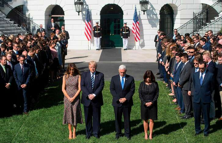 US President Donald Trump First Lady Melania Trump, US Vice President Mike Pence and his wife, Karen, participate in a moment of silence on the South Lawn of the White House in Washington, DC, October 2, 2017, for the victims of the shooting yesterday in Las Vegas, Nevada. / AFP PHOTO / SAUL LOEBSAUL LOEB/AFP/Getty Images