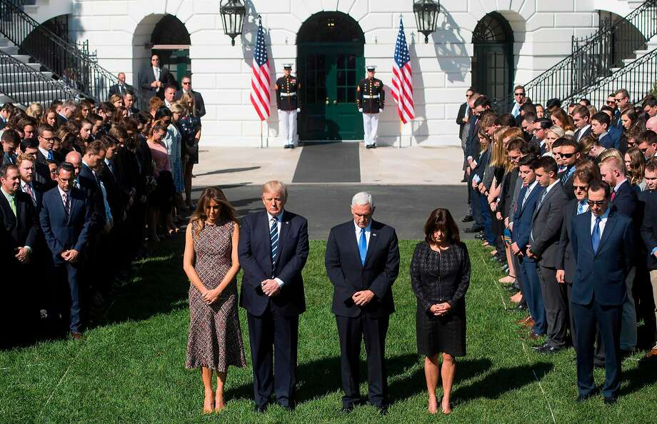 US President Donald Trump First Lady Melania Trump, US Vice President Mike Pence and his wife, Karen, participate in a moment of silence on the South Lawn of the White House in Washington, DC, October 2, 2017, for the victims of the shooting yesterday in Las Vegas, Nevada. / AFP PHOTO / SAUL LOEBSAUL LOEB/AFP/Getty Images Photo: SAUL LOEB, AFP/Getty Images