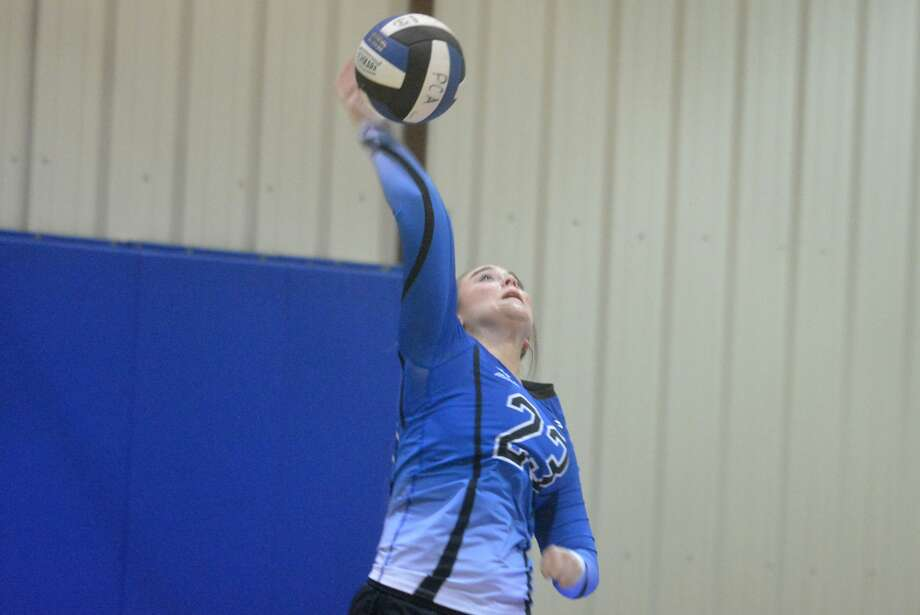 Plainview Christian Academy's Ashlynn Morton serves during a volleyball match earlier this season. The Lady Eagles won their opening district contest and will go for two in a row Tuesday night. Photo: Skip Leon/Plainview Herald