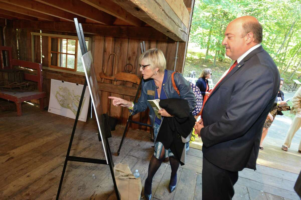 First County Bank Chief Digital Banking Officer Karen Kelly and President Robert Granata look at renderings of the Stamford Museum and Nature Center Environmental Education Farmhouse during groundbreaking ceremonies, on Monday October 2, 2017 in Stamford Conn.