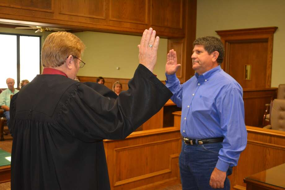Brent Hackett (right) is administered the oath of office as Hale County Precinct 1 Constable by County Judge Bill Coleman during a ceremony at 4 p.m. Monday in the second floor courtroom at the Hale County Courthouse. A retired Lubbock police officer, Hackett, 54, fills a vacancy created by the July 12 death of Mark Mull, 51, who was constable for 15 years. Hackett grew up in Plainview and graduated from Plainview High School. He worked at Plainview Plate Glass and later Crafton's Glass in Lubbock before joining the Lubbock Police Department as a patrol officer in October 1991. He retired May 2014.