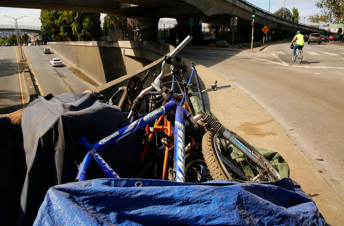 Many bicycles and their parts are found along the sidewalk along Cesar Chavez st. under the 101 freeway as seen on Fri. Sept. 29, 2017, in San Francisco, Ca. There's a bill that San Francisco lawmakers are expected to pass that would make it much more difficult to operate a bicycle chop shop on the city's streets.