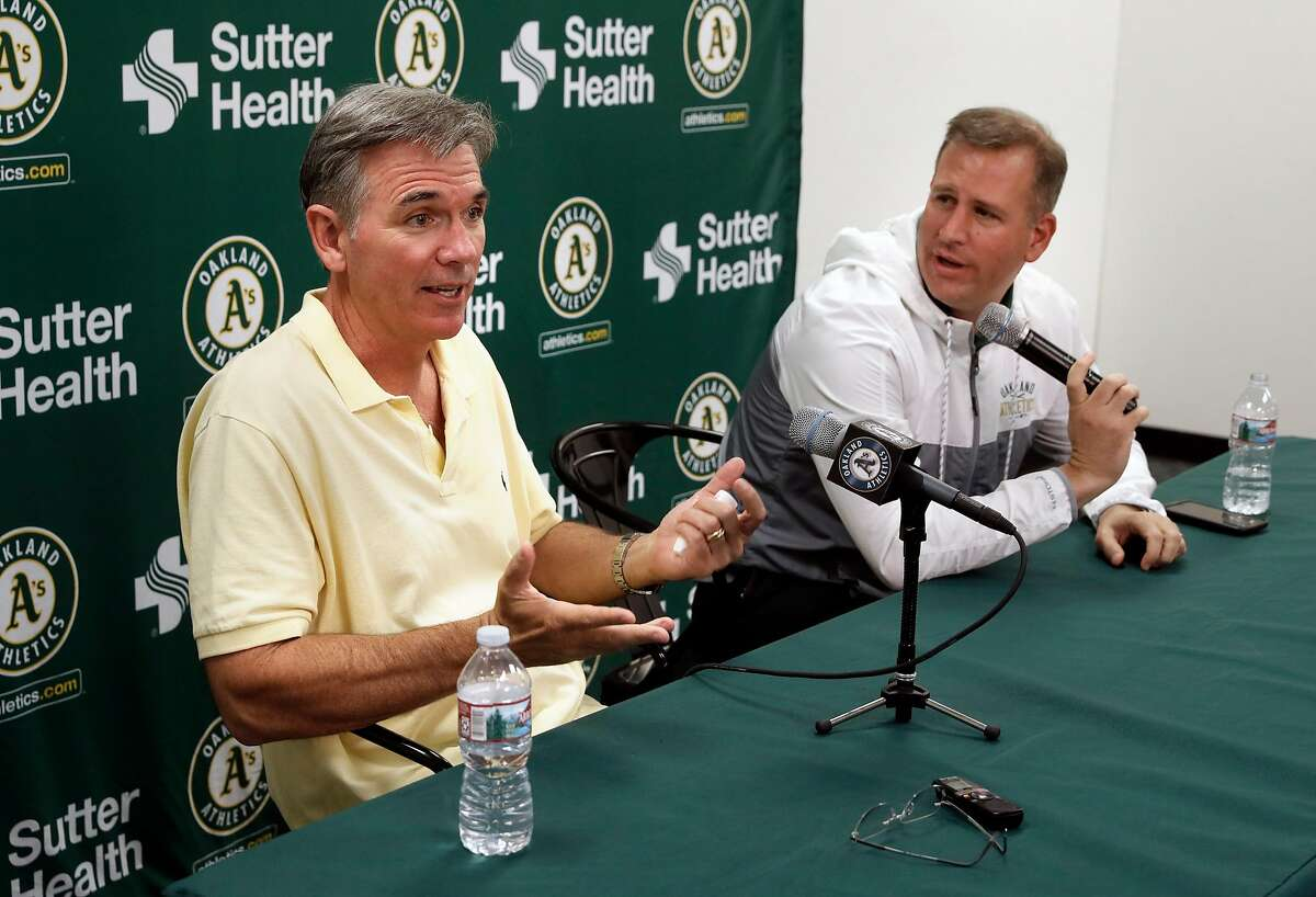 Oakland Athletics VP of baseball operations Billy Beane, (left) and general manager David Forst talk about the end of the season during a press conference at the Oakland Coliseum on Mon. Oct. 2, 2017, in Oakland, Ca.