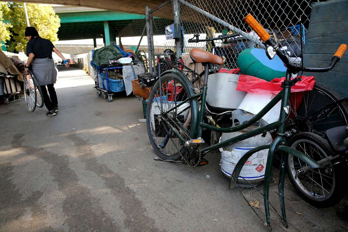 Many bicycles and their parts are found along the sidewalk along Cesar Chavez st., under the 101 freeway as seen on Fri. Sept. 29, 2017, in San Francisco, Ca. There's a bill that San Francisco lawmakers are expected to pass that would make it much more difficult to operate a bicycle chop shop on the city's streets.