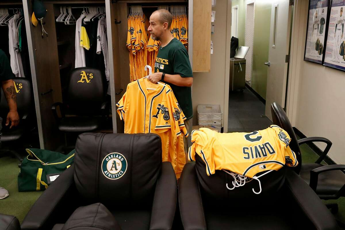 Oakland Athletics' assistant clubhouse manager Brian Davis, packs up uniforms inside the clubhouse at the end of the season at the Oakland Coliseum on Mon. Oct. 2, 2017, in Oakland, Ca.