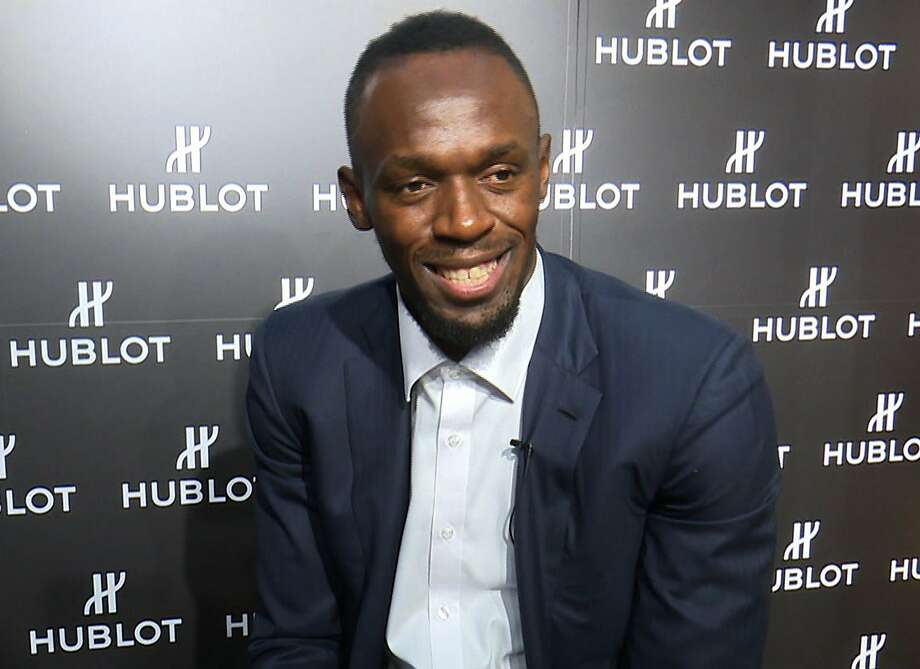 In this image made from video, Usain Bolt of Jamaica speaks during an interview in Kyoto, western Japan, Tuesday, Sept. 5, 2017.  Bolt is feeling no pressure in retirement, confident his best times can remain world records for decades. The only sprinter to capture the 100- and 200-meter track titles at three consecutive Olympics, Bolt retired last month after the world championships in London. He holds the world record of 9.58 seconds in the 100 and 19.19 in the 200 — both set in Berlin in 2009.  (AP Video via AP) Photo: Associated Press