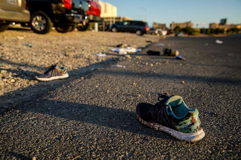 Discarded personal items covered in blood sit on Kovaln Lane, in the aftermath of the mass shooting  leaving at least 58 dead and more than 500 injured, in Las Vegas, Nevada, on Oct. 2, 2017. (Marcus Yam/Los Angeles Times/TNS) Photo: Marcus Yam, TNS
