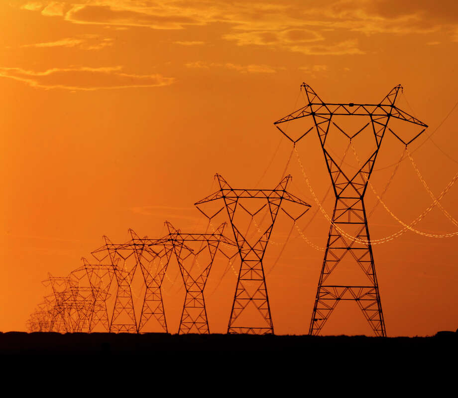 High voltage electric transmission lines are silhouetted against the late day sky near Spearville, Kan. (Associated Press File Photo) Photo: CHARLIE RIEDEL, CTR / RIACE