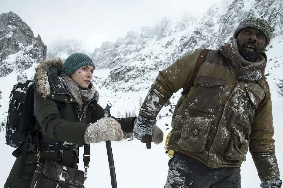 "Kate Winslet and Idris Elba star in the harrowing plane-crash movie ""The Mountain Between Us."" Photo: Kimberley French, Associated Press"