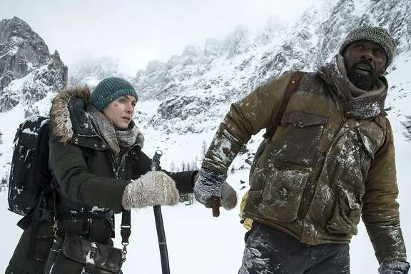 """This image released by Twentieth Century Fox shows Kate Winslet, left, and Idris Elba in a scene from """"The Mountain Between Us."""" (Kimberley French/Twentieth Century Fox via AP)"""