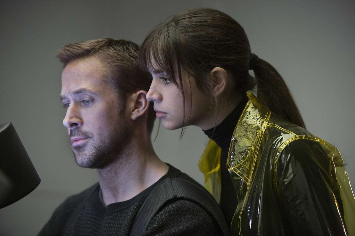 """This image released by Warner Bros. Pictures shows Ryan Gosling, left, and Ana de Armas in a scene from """"Blade Runner 2049."""" (Stephen Vaughan/Warner Bros. Pictures via AP)"""