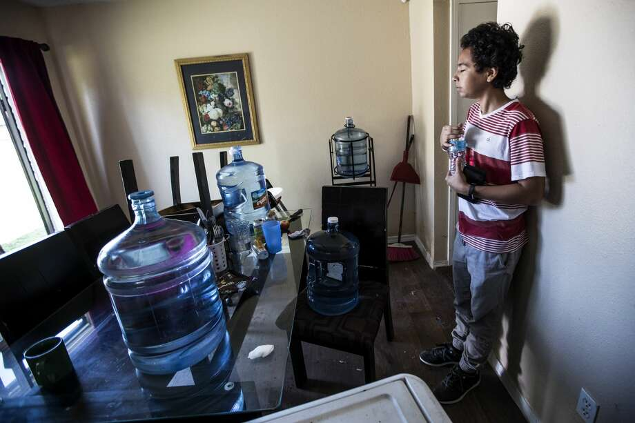 Darrel Rosales, 14, takes a break from cleaning up his flood-damaged home in the aftermath of Tropical Storm Harvey in the Verde Forest subdivision on Thursday, Aug. 31, 2017, in Houston. His family evacuated to the Toyota Center. ( Brett Coomer / Houston Chronicle ) Photo: Brett Coomer/Houston Chronicle
