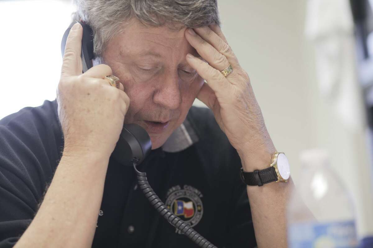 Harris County Judge Ed Emmett talks on the phone in his office on Thursday, August 31, 2017, days after Hurricane Harvey came ashore in Texas. ( Elizabeth Conley / Houston Chronicle )