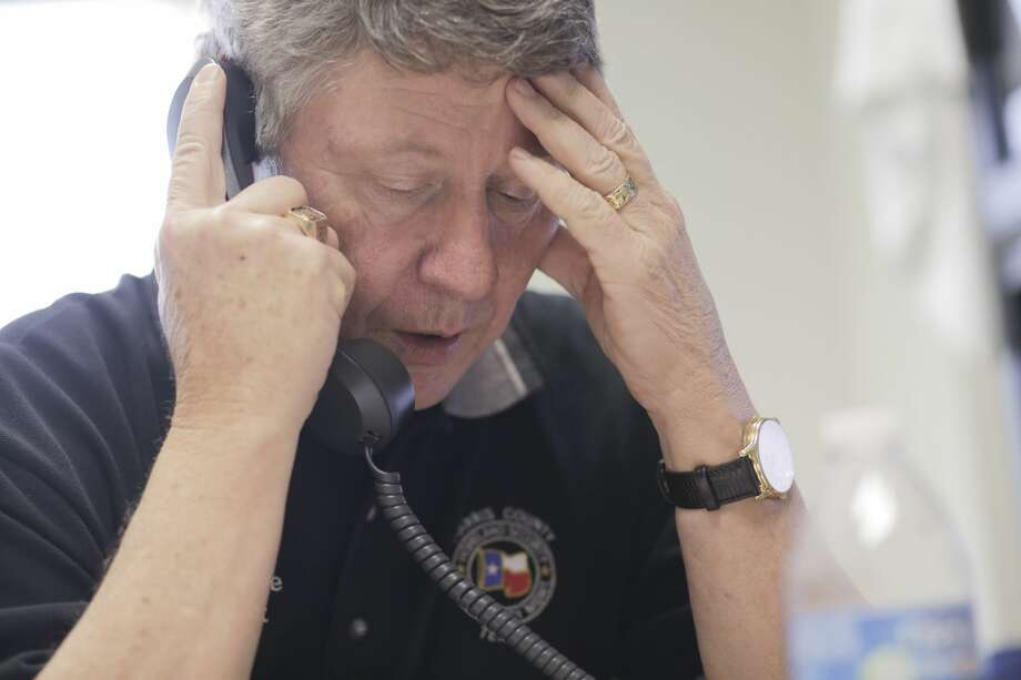 Harris County Judge Ed Emmett talks on the phone in his office on Thursday, August 31, 2017, days after Hurricane Harvey came ashore in Texas. ( Elizabeth Conley / Houston Chronicle ) Photo: Elizabeth Conley/Houston Chronicle