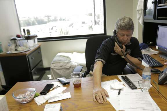 Harris County Judge Ed Emmett talks on the phone in his office on Thursday, August 31, 2017 on Thursday, Aug. 31, 2017, in Houston. ( Elizabeth Conley / Houston Chronicle )