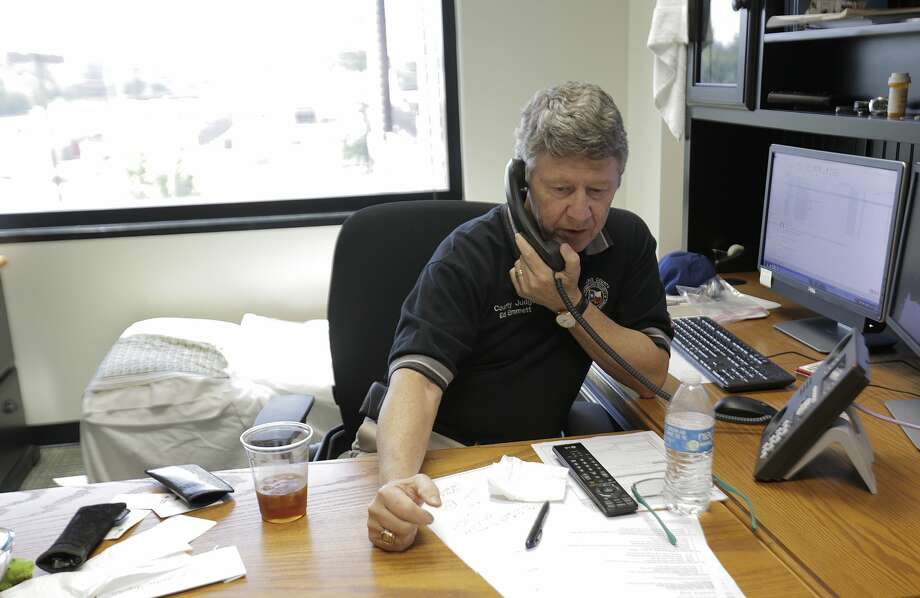 Harris County Judge Ed Emmett talks on the phone in his office on Thursday, August 31, 2017 on Thursday, Aug. 31, 2017, in Houston. ( Elizabeth Conley / Houston Chronicle ) Photo: Elizabeth Conley/Houston Chronicle