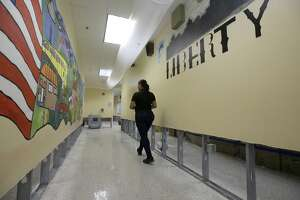 Mary Pinales, with Blackmon Mooring, walks through Liberty High School, 6400 Southwest Fwy., where the walls were cut two feet up to dry out the school Thursday, Aug. 31, 2017, in Houston.  Many schools were damaged from flooding in the aftermath of Hurrican Harvey. ( Melissa Phillip / Houston Chronicle )