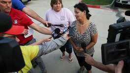 Frances Breaux, center, talks to media about her close friends and neighbors Leo and Lajayne Opelia, both in their 70s. She hasn't being able to reach them since last night, before the organic peroxides inside the Arkema chemical plant exploded Thursday, Aug. 31, 2017, in Crosby, Texas. The Opelias were mandatorily evacuated from their homes by officials but they decided to sneak back in their home. ( Godofredo A. Vasquez / Houston Chronicle )