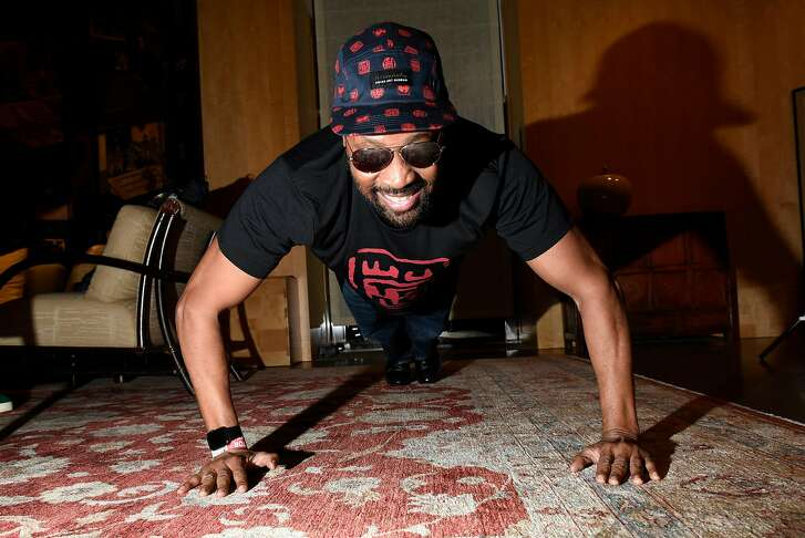 The RZA does push-ups back stage during a launch party for his clothing line, 36 Chambers, at the Asian Art Museum in San Francisco, Calif., on Thursday September 21, 2017.