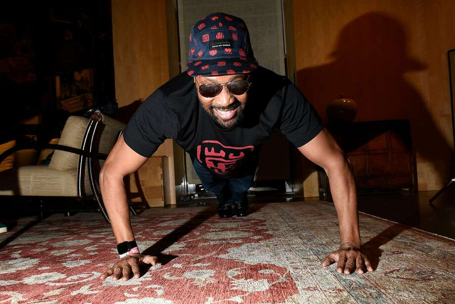 RZA does push-ups back stage during the drop party for his clothing line, 36 Chambers, at the Asian Art Museum. Photo: Michael Short, Special To The Chronicle