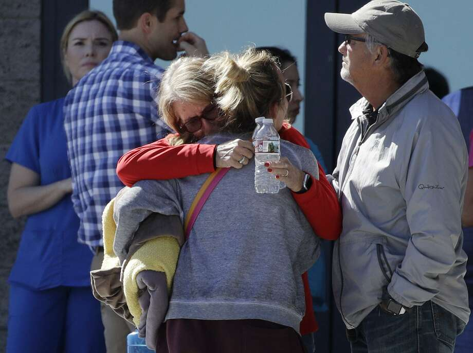 Two women embrace outside of a family assistance center Monday, Oct. 2, 2017, in Las Vegas. The makeshift center was set up to help families and others reconnect after the mass shooting on the Las Vegas Strip. (AP Photo/John Locher) Photo: John Locher, STF / Associated Press / Copyright 2017 The Associated Press. All rights reserved.