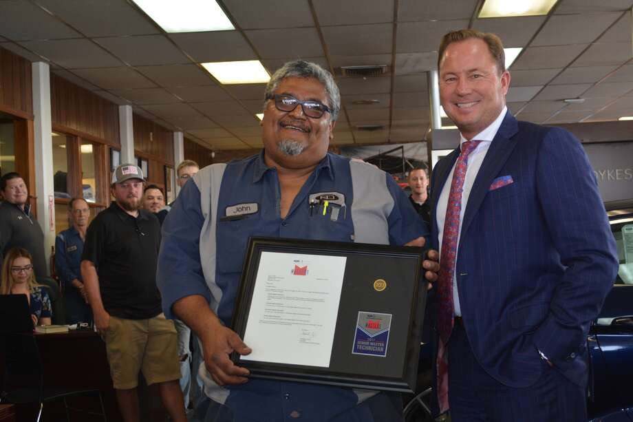 Reagor Dykes Ford Lincoln service technician John J. Leija receives his Ford 2017 Senior Master certification from Bart Reagor, co-owner of Reagor Dykes Auto Group, during a special ceremony at the Plainview dealership on Monday. Leija has been on the staff of the local dealership for 37 years.