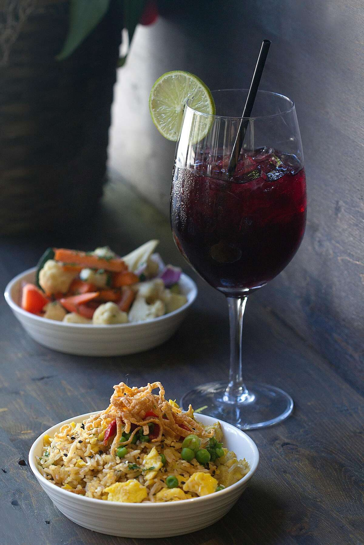 Peruvian fried rice, saut�ed vegetables and chicha morada at Alma Cocina on Thursday, September 28, 2017, in San Francisco, Calif.
