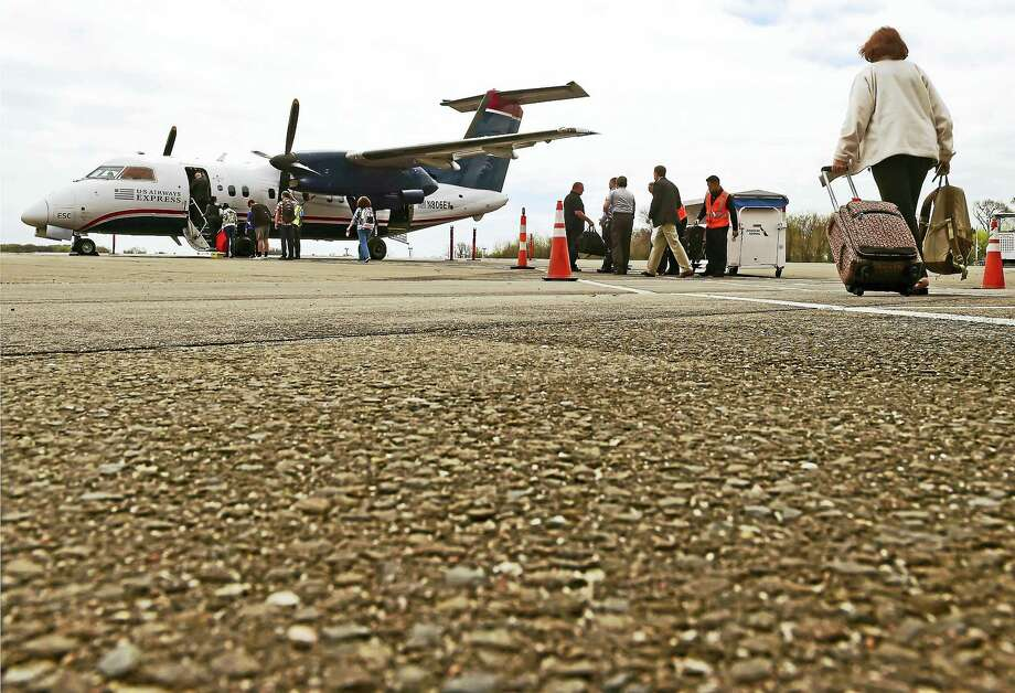 A U.S. Airways Express commercial aircraft boards passengers at Tweed-New Haven Airport. Photo: Peter Hvizdak / Hearst Connecticut Media / ©2017 Peter Hvizdak