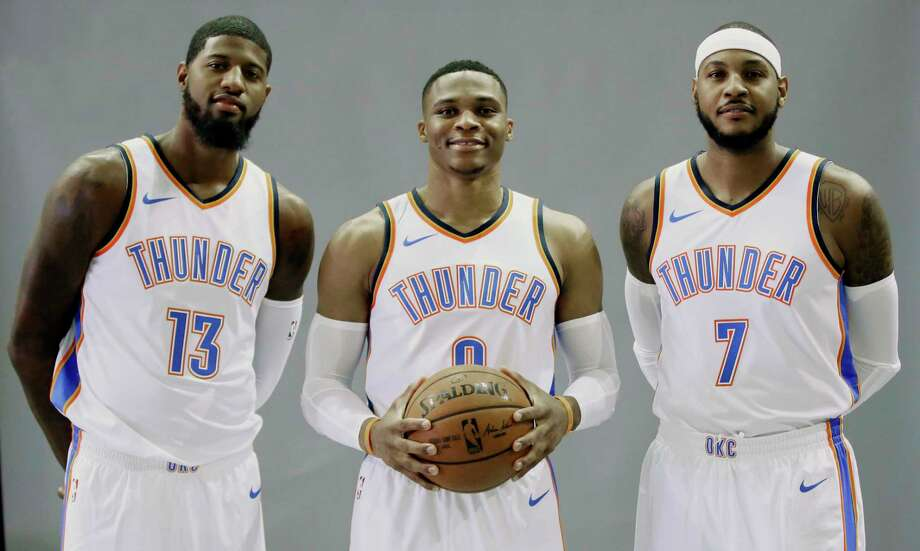 Oklahoma City Thunder's Paul George (13), Russell Westbrook, center, and Carmelo Anthony (7) pose for a photo during an NBA basketball media day in Oklahoma City, Monday, Sept. 25, 2017. (AP Photo/Sue Ogrocki) Photo: Sue Ogrocki, STF / AP2017