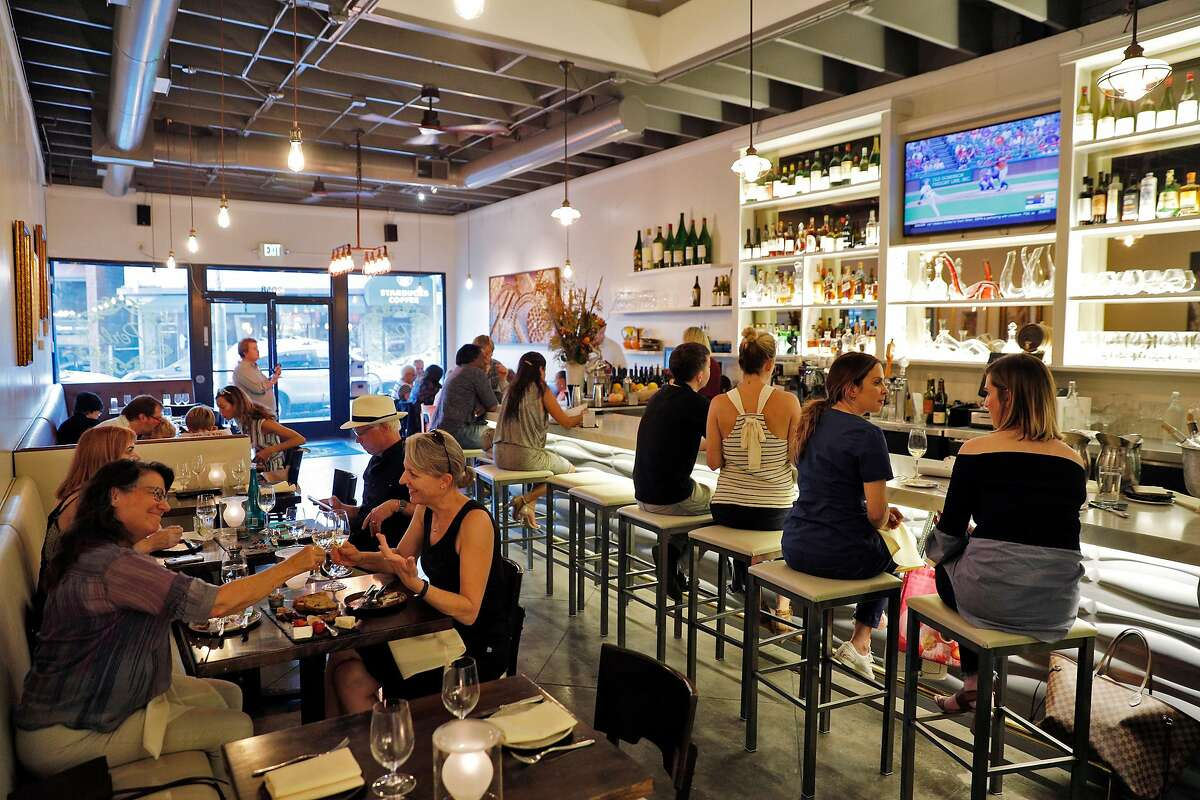 The dining room and bar at Perle, the new restaurant venture by SF restaurant vets, Marcus Garcia and Robert Lam in Oakland, Calif., on Wednesday, September 27, 2017.