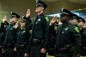 New Houston Police officers are swornb in during the graduation ceremony of HPD Cadet Class 232 at Greater Grace Outreach Church on Monday, Oct. 2, 2017, in Houston. There were 59 new officers to be sworn in during the ceremony.