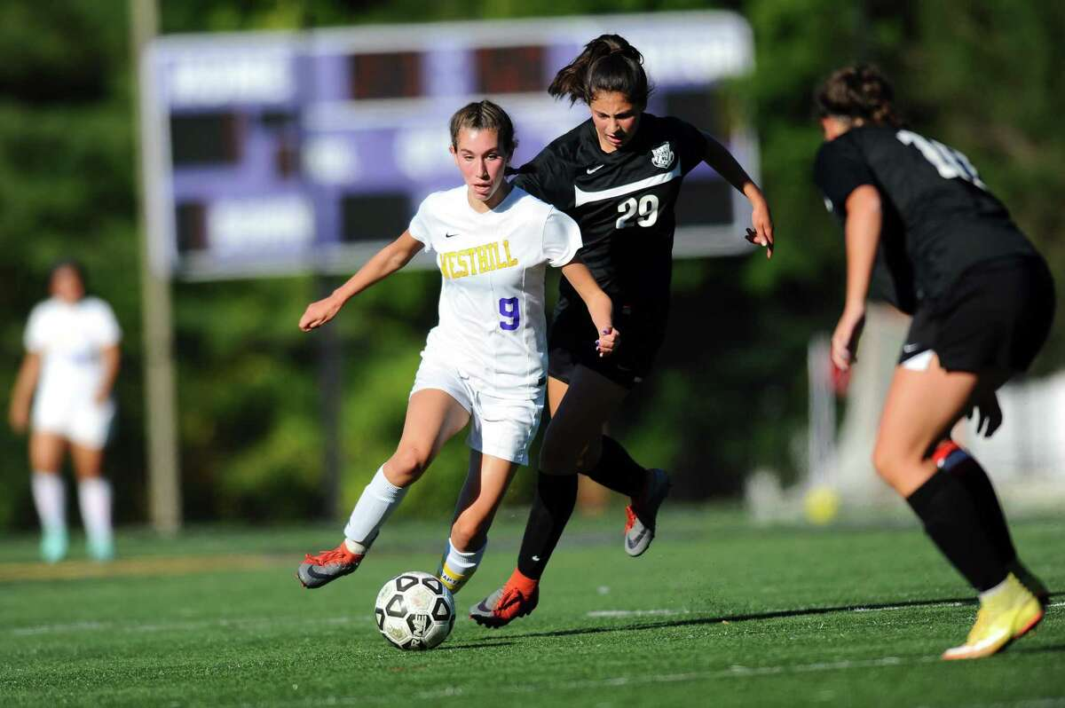 Westhill High School junior Corinne Dente outpaces Trumbull High School freshman Ana Carlos during the varsity girls soccer game at Westhill High School in Stamford, Conn. on Monday, Oct. 2, 2017.