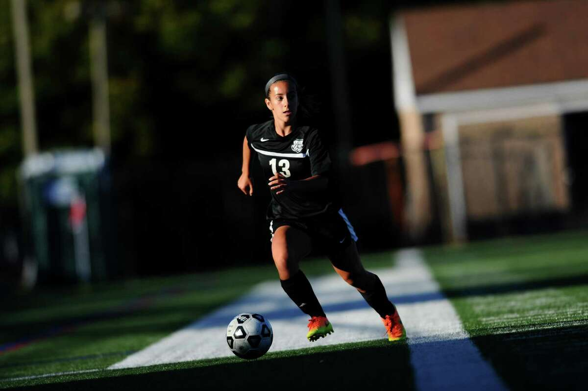Trumbull High School junior Jessica Esposito looks for a teammate while dribbling towards the Westhill goal during the varsity girls soccer game at Westhill High School in Stamford, Conn. on Monday, Oct. 2, 2017.