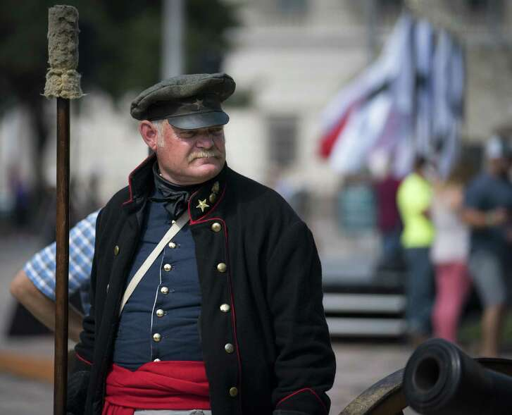Alamo living historian George Rollow stands by a three-pound cannon during the conclusion of Cannon Fest, Monday, Oct. 2, 2017, at the Alamo in San Antonio. (Darren Abate/For the Express-News)