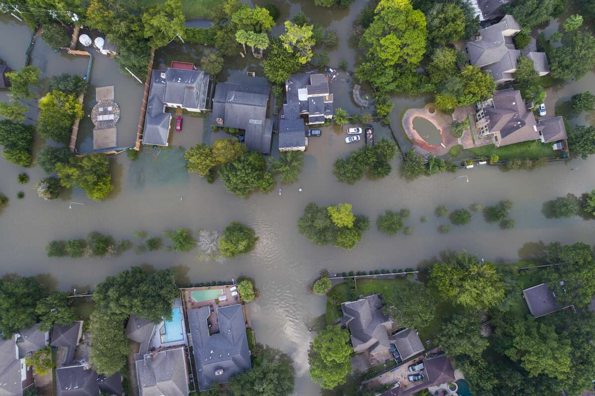 Homes along S. Kirkwood Rd. west of Beltway 8 and south of Interstate 10 are inundated with water from the overflowing Buffalo Bayou to the north, Saturday, September 2, 2017, in Houston. Houston mayor Sylvester Turner issued a new mandatory evacuation order Saturday for homes with water in them south of Interstate 10, north of Briar Forest, east of Highway 6 and west of Gessner Rd. As water continues to be released from the Addicks and Barker reservoirs. (Mark Mulligan / Houston Chronicle)