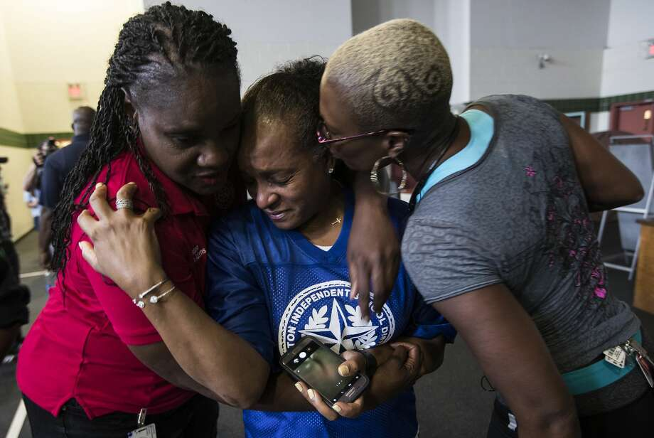 Wanda Adams, left, Rhonda Skillern-Jones, and Jolanda Jones, Houston Independent School District board of trustees members, embrace as they tour flood-damaged A.G. Hilliard Elementary School in the aftermath of Tropical Storm Harvey, on Saturday, Sept. 2, 2017, in Houston. ( Brett Coomer / Houston Chronicle ) Photo: Brett Coomer/Houston Chronicle
