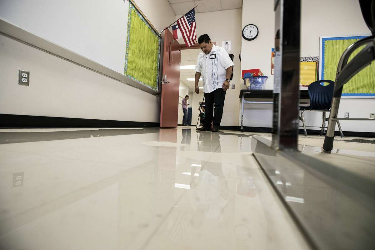 Richard Carranza, Houston Independent School District superintendent, walks through a flood damaged classroom during a tour of A.G. Hilliard Elementary School, which was flooded by Tropical Storm Harvey, on Saturday, Sept. 2, 2017, in Houston. ( Brett Coomer / Houston Chronicle )