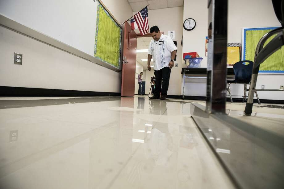 Richard Carranza, Houston Independent School District superintendent, walks through a flood damaged classroom during a tour of A.G. Hilliard Elementary School, which was flooded by Tropical Storm Harvey, on Saturday, Sept. 2, 2017, in Houston. ( Brett Coomer / Houston Chronicle ) Photo: Brett Coomer/Houston Chronicle