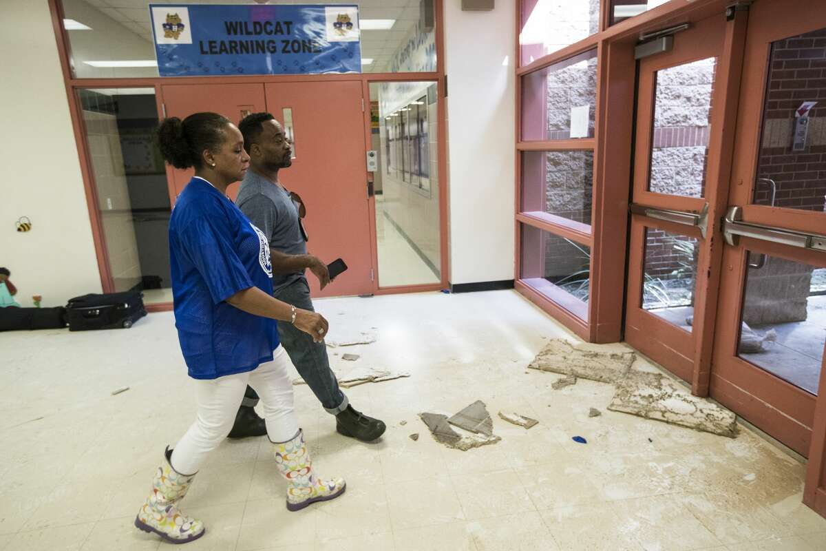 Rhonda Skillern-Jones, Houston Independent School District board trustee, walks out of flood-damaged A.G. Hilliard Elementary School, following a tour of the school in the aftermath of Tropical Storm Harvey, on Saturday, Sept. 2, 2017, in Houston. ( Brett Coomer / Houston Chronicle )