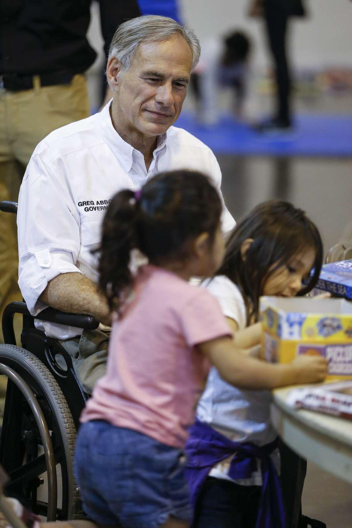 Texas Gov. Greg Abbott visits Hurricane Harvey evacuees at NRG Center in Houston on Saturday, Sept. 2, 2017.