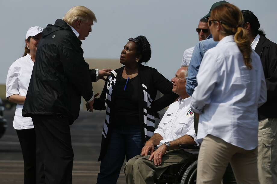President Donald Trump speaks with congresswoman Sheila Jackson Lee, center, and Texas governor Greg Abbott, right, as he visits Houston in the wake of Tropical Storm Harvey Saturday, Sept. 2, 2017. ( Michael Ciaglo / Houston Chronicle) Photo: Michael Ciaglo/Houston Chronicle