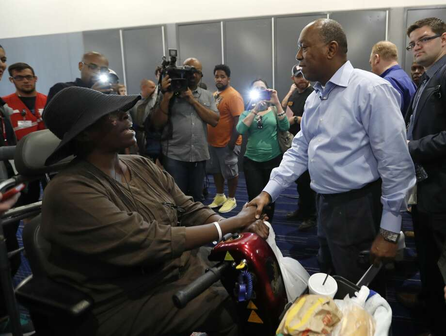 Mayor Sylvester Turner shakes hands with Marva Hill, who was evacuated from the Fifth Ward, at the George R. Brown Convention Center, where the Red Cross had set up a shelter for those displaced by Tropical Storm Harvey, Friday, Sept. 1, 2017, in Houston.   ( Karen Warren / Houston Chronicle ) Photo: Houston Chronicle